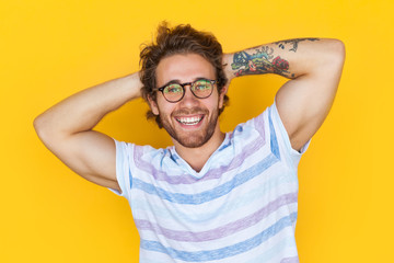 Cheerful handsome man with tattooed arm