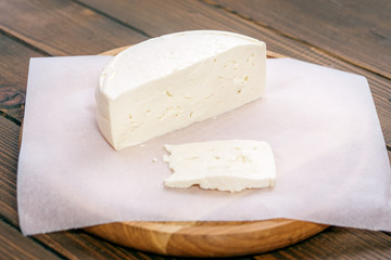 Homemade cheese from the farm. The concept is healthy food, restaurant, cafe, vegetarianism.