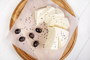 Feta cheese with sesame seeds. Top view. The concept is healthy food, vegetarianism, farm.