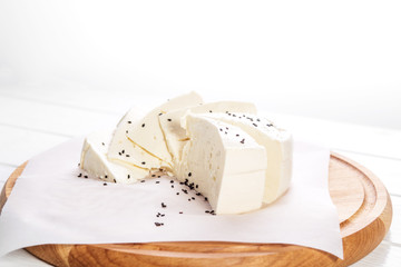 Delicious useful mozzarella cheese with sesame seeds. The concept is healthy food, vegetarianism, farm.