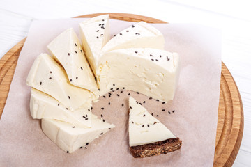 Mozzarella with sesame seeds. Sandwich with cheese. Top view. The concept is healthy food, vegetarianism, farm.