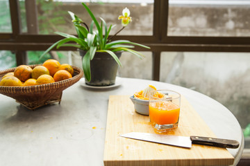 Oranges are squeezed by hand to make a pure and healthy orange juice, 100 percent of natural, and fresh full of vitamins