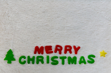 erry Christmas wording on wool background with copy space