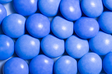 Close up a colorful candies of chocolates with blue colors