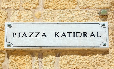 Cathedral Square sign written in Maltese on a building wall within the citadel, Rabat, Gozo, Malta.