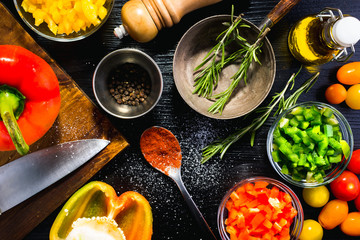 Various ingredients and spices to follow a specific recipe.