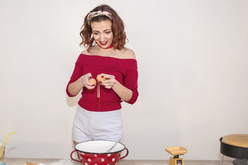 Beautiful Attractive Woman Cracking Eggs - Retro Vintage 50s style