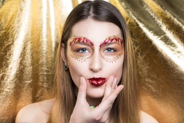 Woman gold closeup