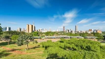 Wall Mural - Long exposure timelapse sequence of the skyline of Nairobi, Kenya with Uhuru Park in the foreground in 4K