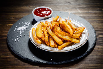 Chips on wooden background