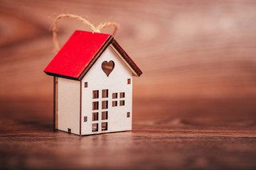 Valentine's day. House symbol on a brown wooden background