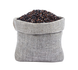 Black rice in burlap bag isolated on white