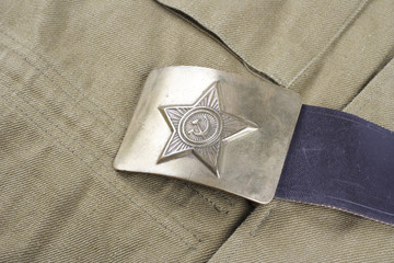 vintage buckle on USSR Soviet Army khaki uniform background