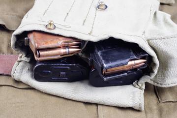 AK47 cartridge magazine on USSR Soviet Army khaki uniform background