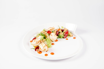 Starter: Mix salads, baked goat cheese, sea-buckthorn jam, caramelized pear with thyme, plum and roast nuts - on a white background