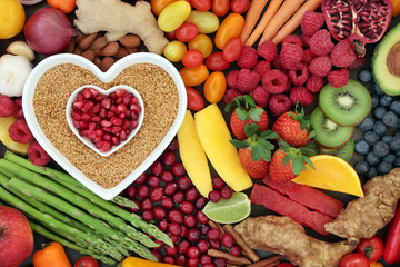 Health food for heart fitness with seeds, vegetables, fruit, nuts, herbs and spice. Superfood concept high in omega 3 fatty acid, anthocyanins, fibre, antioxidants, minerals and vitamins.