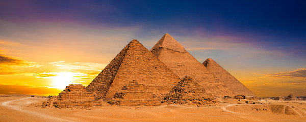 Fotobehang Egypte Great Pyramids of Giza, Egypt, at sunset