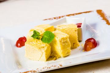 Indian sweet dessert. Soan Papdi on white plate