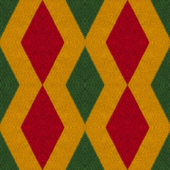 Reggae colors crochet knitted style background, top view. Collage with mirror reflection with rhombus. Seamless kaleidoscope montage for cushion, blanket, plaid, t-shirt graphics, cloth, poster.