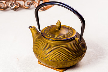 Chinese cast-iron traditional teapot on white table