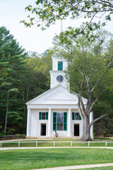 White little country church with tree