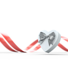 Heart shaped gift box with bow and ribbon