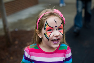 Face Painted Little Girl at a Festival