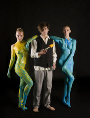 Nude women their body covered with color bodyart