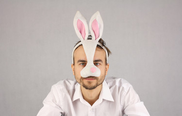 man in the mask Easter rabbit looking at camera