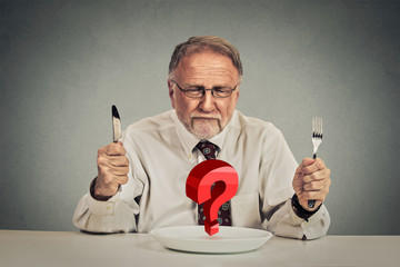 Senior perplexed man choosing meal