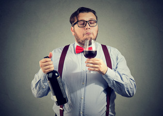 Sommelier smelling wine in glass