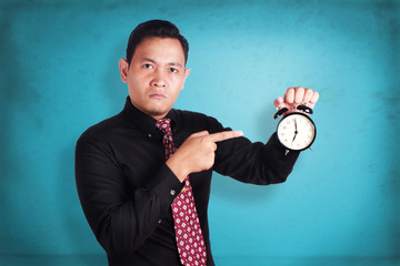 Angry boss showing clock