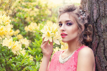 girl in dress in rhododendron garden