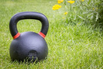 kettlebell on grass - backyard fitness