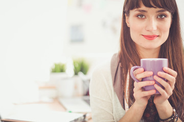 Closeup young woman holding cup of coffee. Young woman