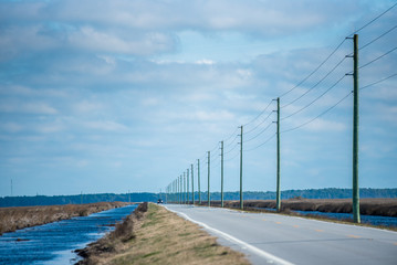 Telephone poles following the highway in North Carolina Fototapete