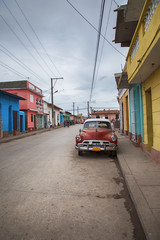Street view with classic car in Cinefuegos, Cuba
