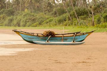 A fishing boat on a sandy beach