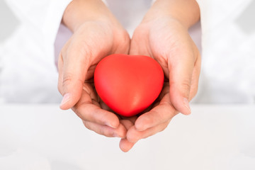 Red heart in hand healthcare concept for World Health Day or Valentine day.