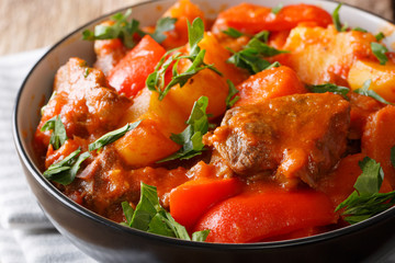 Filipino cuisine: Mechado beef with vegetables in spicy sauce close-up in a bowl. horizontal