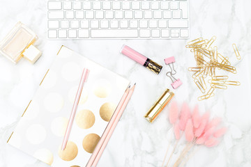 Keyboard and of office items with cosmetics on the desktop. Flat lay