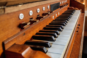 Vintage background with old scratched dusty keys of an ancient organ