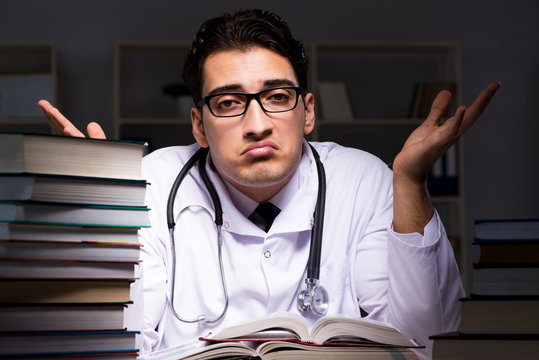 Medical student preparing for university exams at night