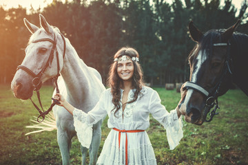Beautiful young woman and horses