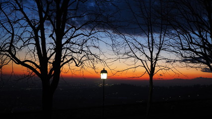 Fiery sunset from the old city of Bergamo to the Po valley. Lombardy, Italy