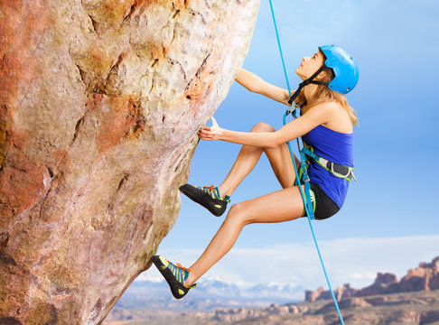 Rock climber trying to reach top of the mountains