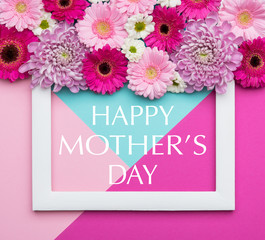 Happy Mother's Day Pastel Candy Coloured Background. Floral mothers day flat lay minimal geometric patterns concept.