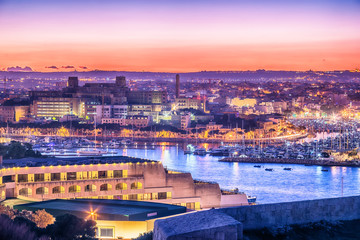 Malta: Il-Gzira and Marsans Harbour. Aerial view from city walls of Valletta at sunset