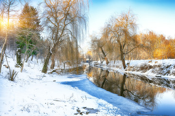 Wall Murals River Winter landscape by a river in the sunset