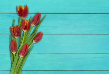 rote tulpen auf türkisem holz